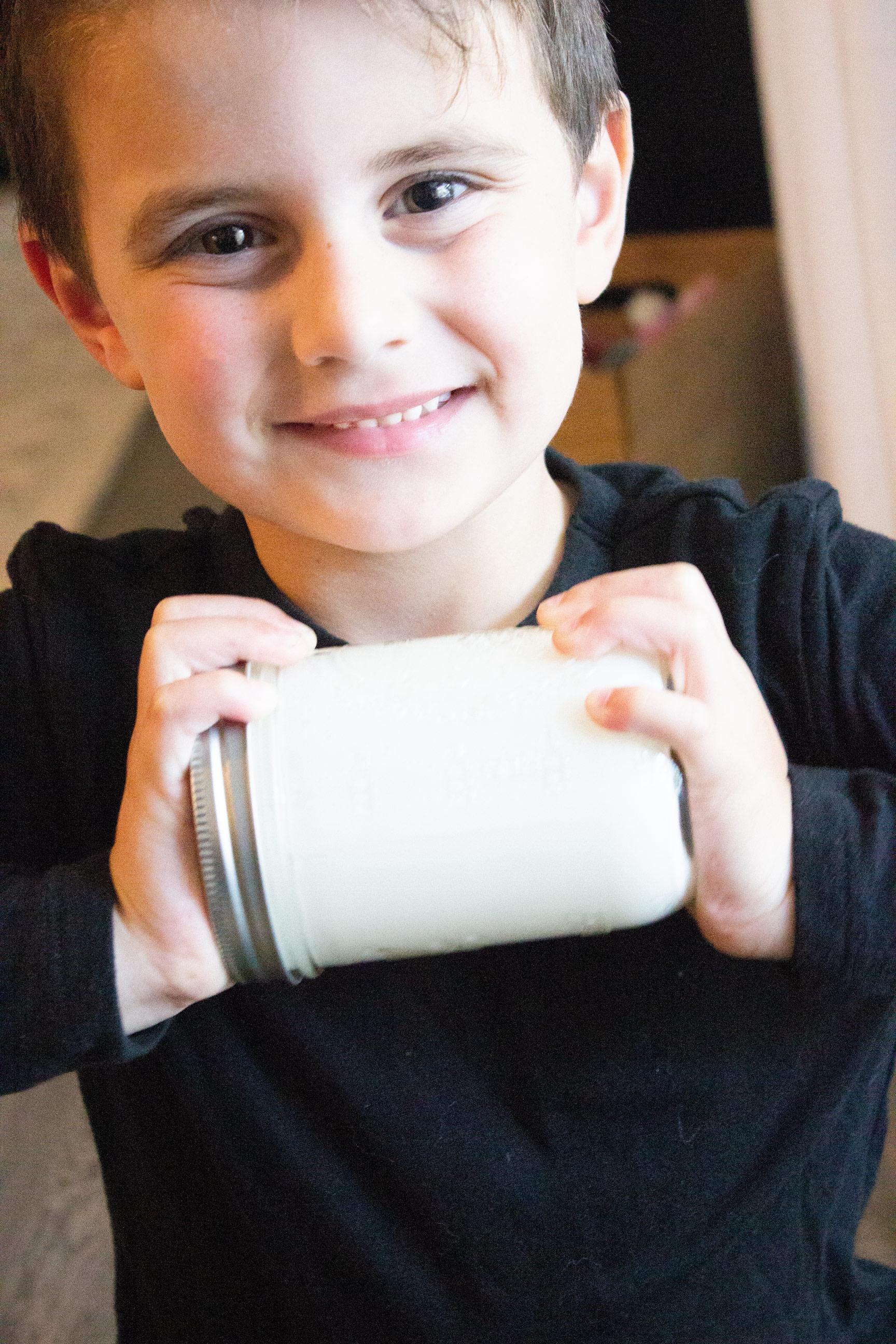 kids shaking mason jars, kids making butter, easy homemade butter