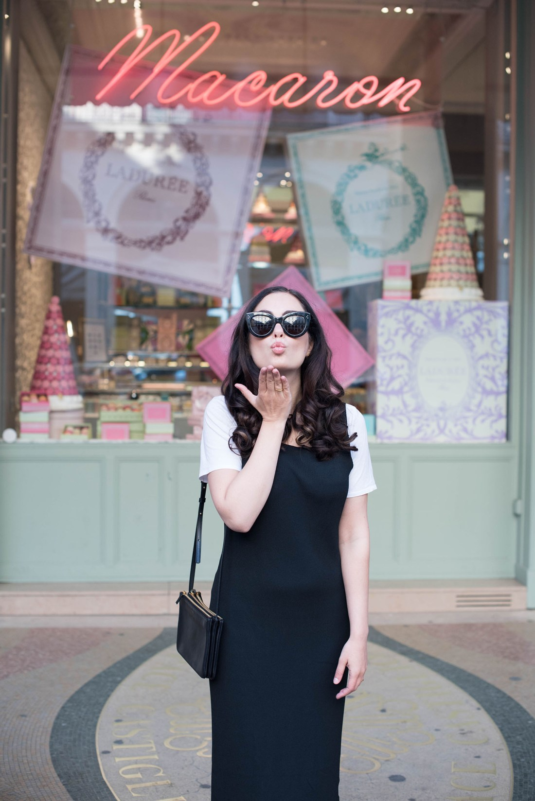 Portrait of brunette fashion blogger Cee Fardoe, wearing Celine Audrey sunglasses and blowing a kiss