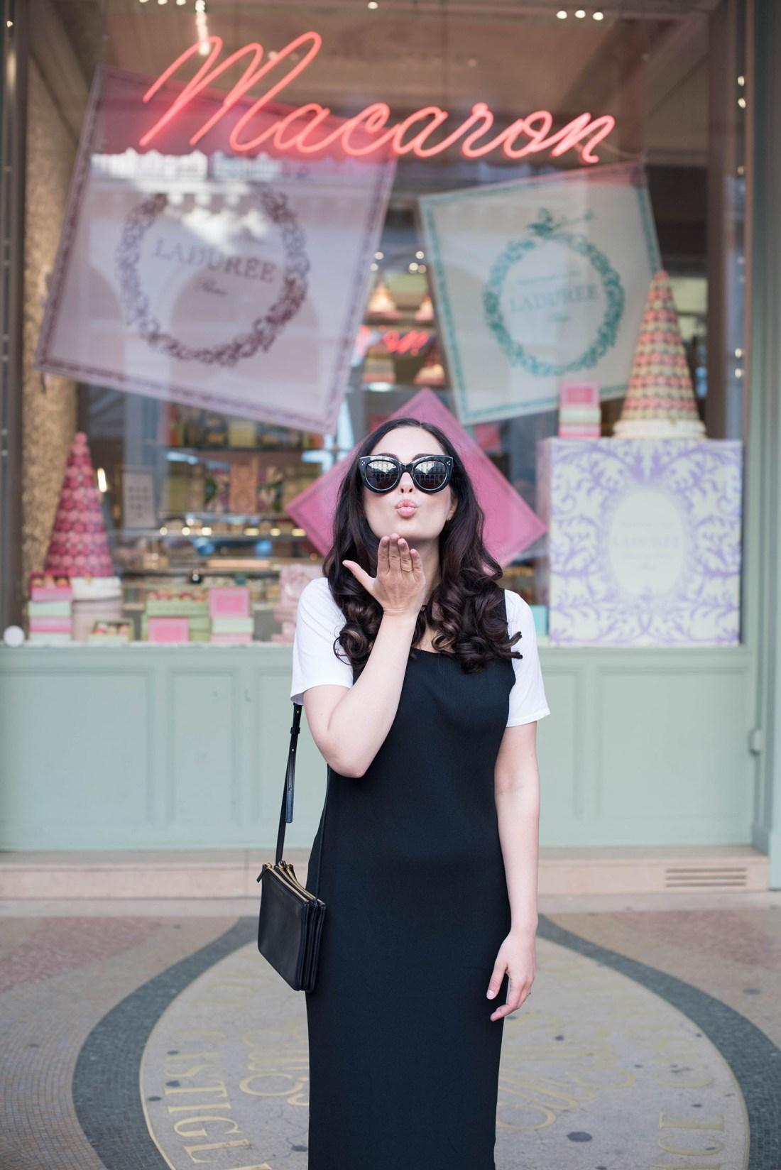 Portrait of brunette fashion blogger Cee Fardoe, wearing Celine Audrey sunglasses and blowing a kiss