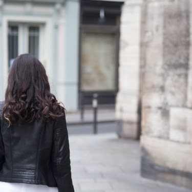 Style blogger Cee Fardoe of Coco & Vera walks on rue Saint-Sulpice in Paris wearing a leather jacket