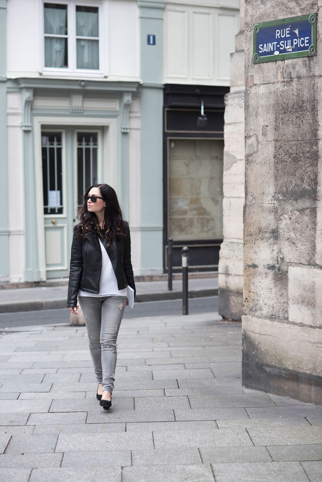 Fashion blogger Cee Fardoe of Coco & Vera wears Zara jeans and a leather jacket in Paris