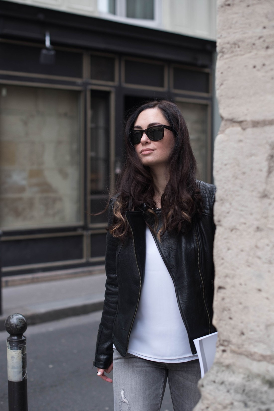 Portrait of fashion blogger Cee Fardoe of Coco & Vera in Paris' Saint-Germain, wearing Ray Ban wayfarer sunglasses