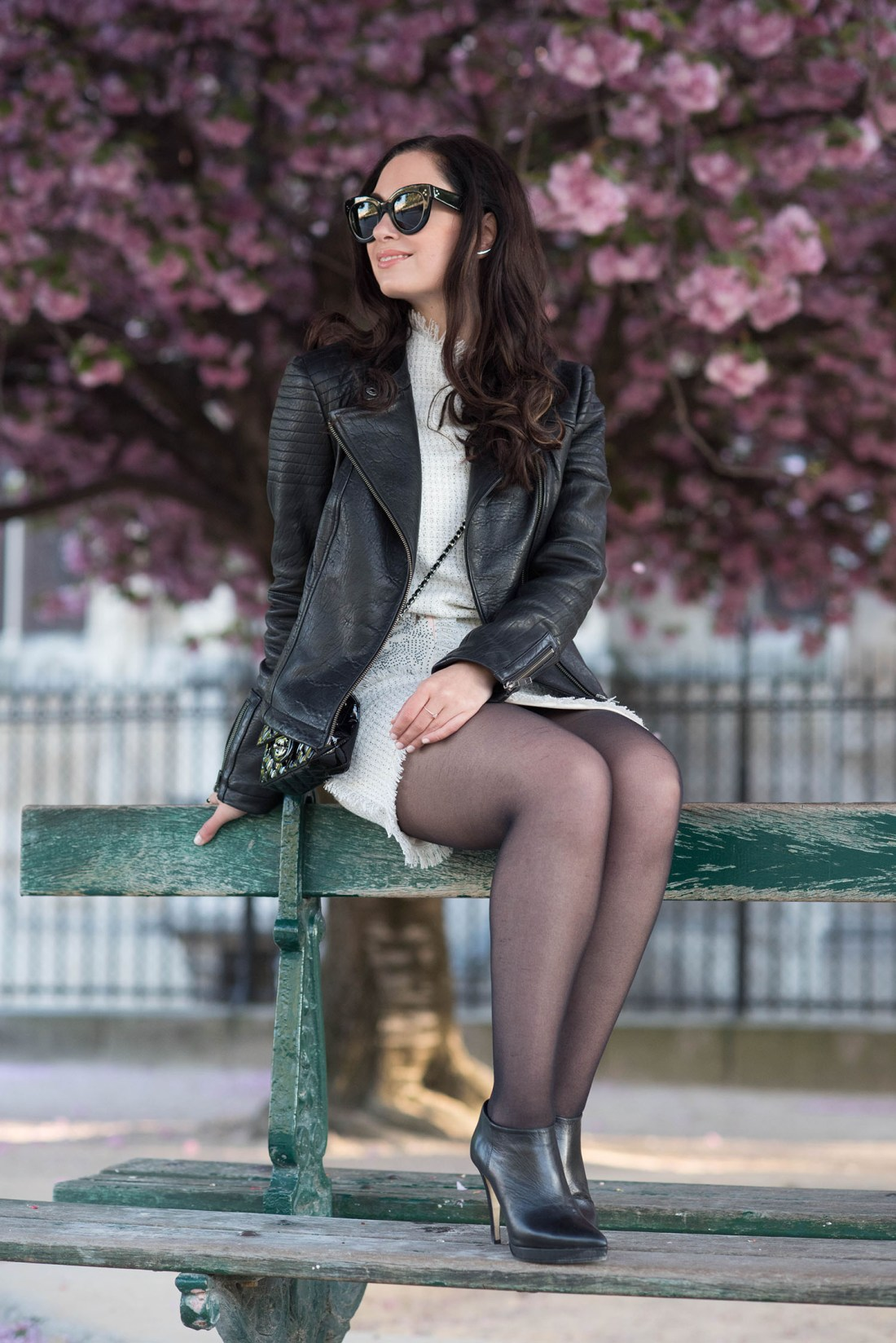 Fashion blogger Cee Fardoe of Coco & Vera sitting on a bench wearing a Floriane Fosso tweed dress