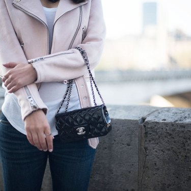 Outfit details on style blogger Coco & Vera, featuring a black Chanel extra mini handbag