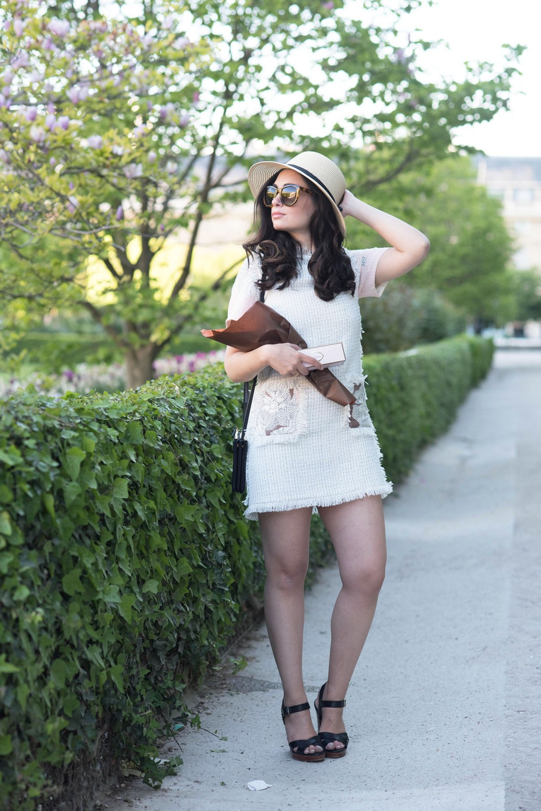Fashion blogger Cee Fardoe of Coco & Vera in the Palais Royal garden in Paris wearing a Floriane Fosso dress and Anine Bing sunglasses