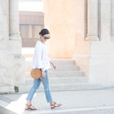 Fashion blogger Cee Fardoe of Coco & Vera walks at St. Boniface cathedral wearing a Missy Empire Araceli blouse, Grlfrnd Karolina jeans and Sezane sandals