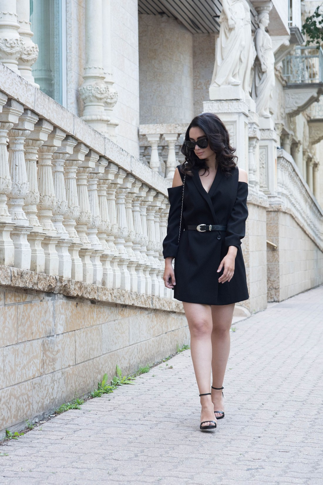 Fashion blogger Cee Fardoe of Coco & Vera walks past Fort Garry Place in Winnipeg wearing an Ever New dress, Steve Madden sandals and vintage belt