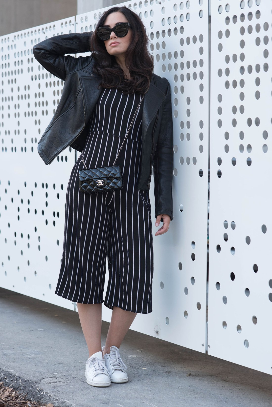 Fashion blogger Cee Fardoe of Coco & Vera wears a striped Missy Empire jumpsuit with Adidas Stan Smith sneakers and a Chanel extra mini handbag