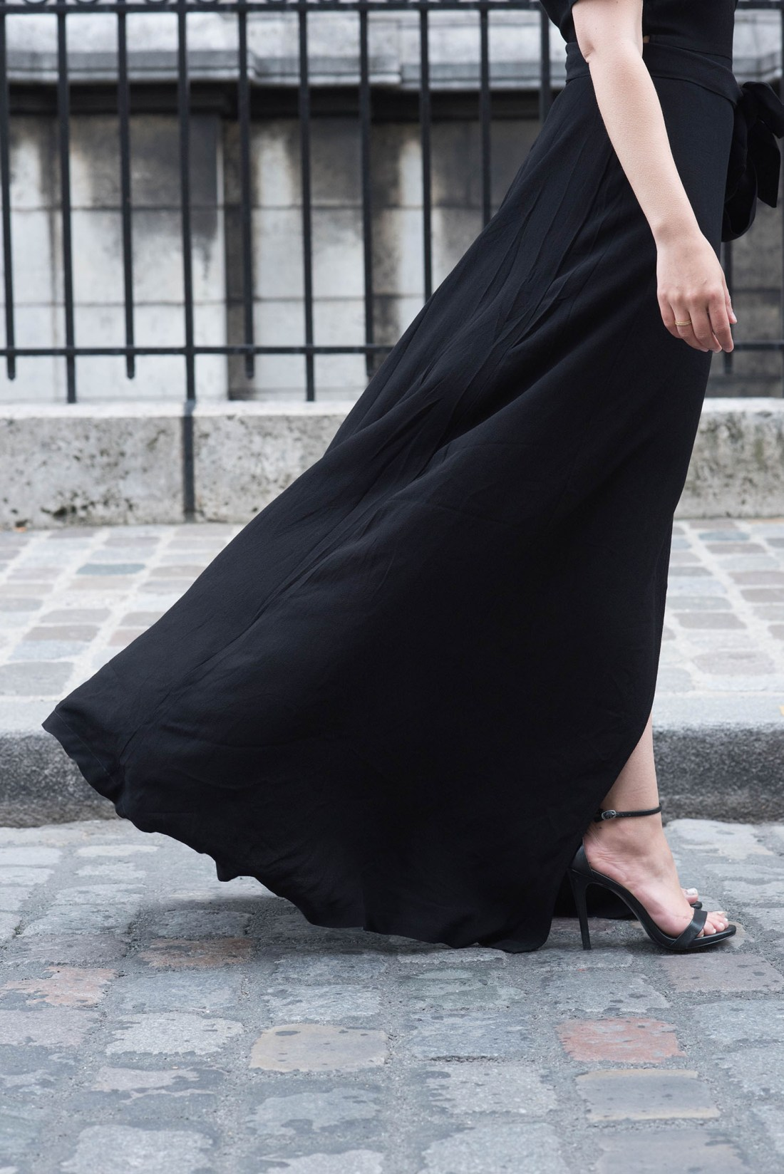 Outfit details on fashion blogger Cee Fardoe of Coco & Vera, including and Ivy & Oak black maxi dress and Steve Madden Stecy sandals