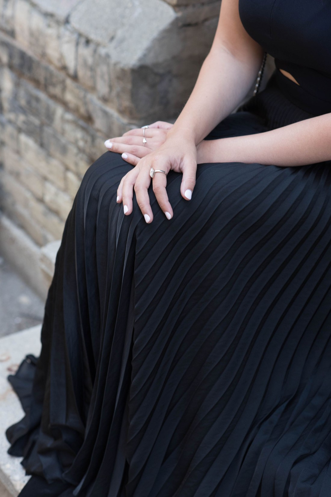 Outfit details on fashion blogger Cee Fardoe of Coco & Vera, including an ALC pleated black dress and Keltie Leanne Designs mirror ring