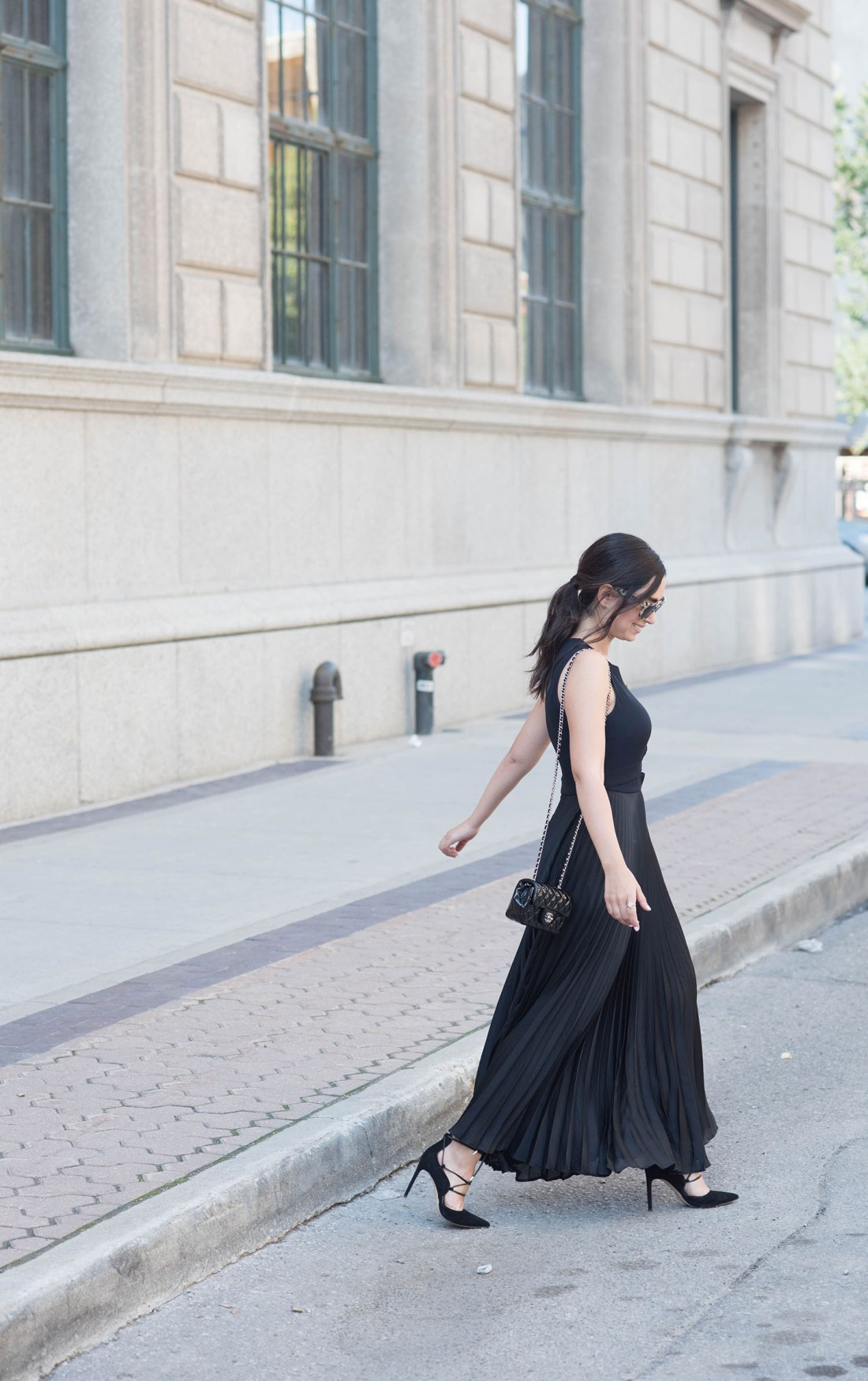 Fashion blogger Cee Fardoe of Coco & Vera wears an ALC pleated maxi dress and a ponytail styled by Fran Rizzutto