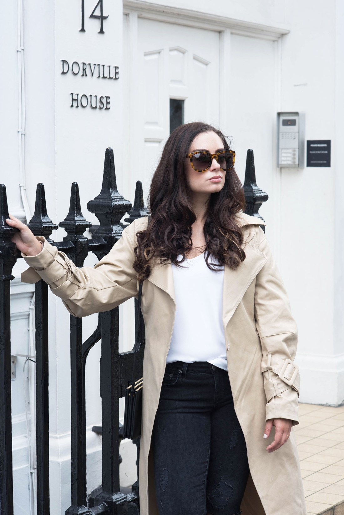 Portrait of style blogger Cee Fardoe of Coco & Vera at Dorville House in London wearing Anine Bing Los Angeles sunglasses and an Express Barcelona tank