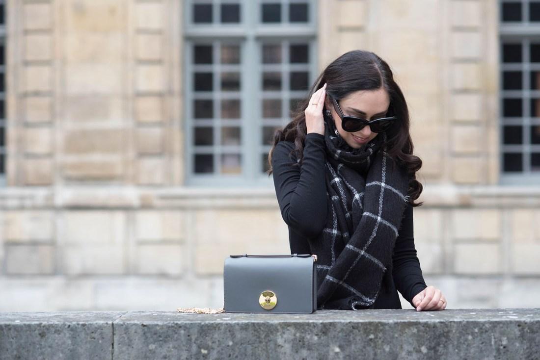 Portrait of Winnipeg fashion blogger Cee Fardoe at the Hotel de Sully in Paris wearing Celine Audrey sunglasses and a Zara checked scarf