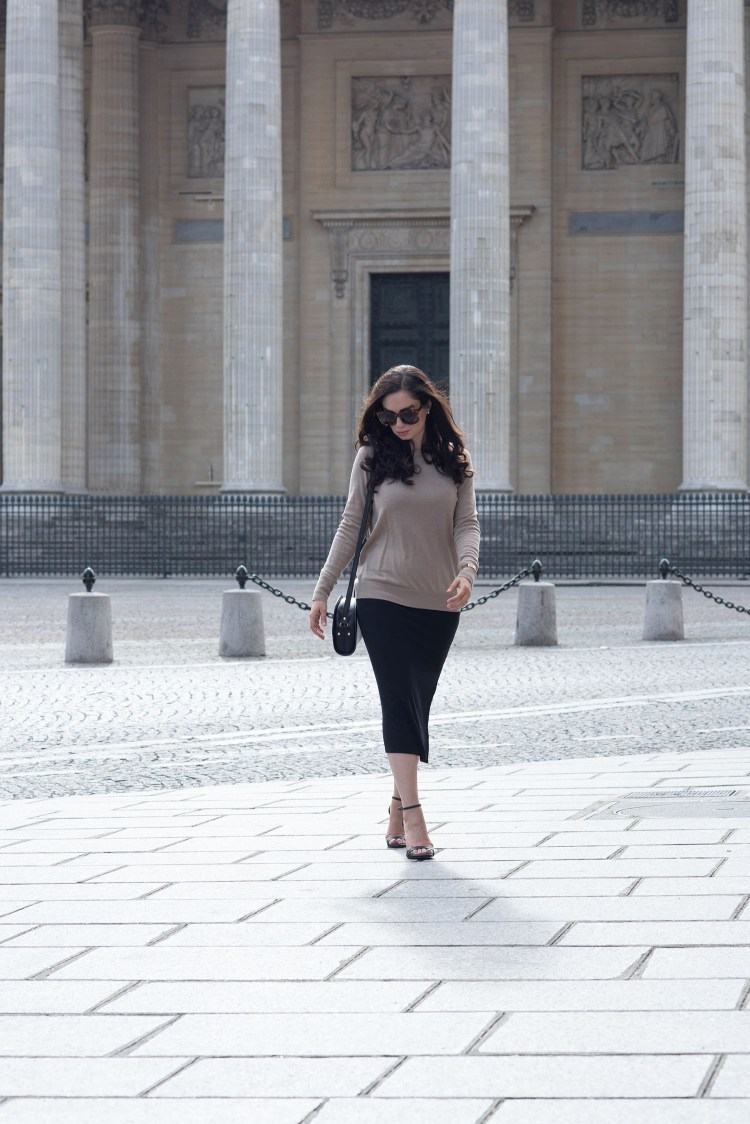 Fashion blogger Cee Fardoe of Coco & Vera walks away from the Pantheon in Paris wearing a Privacy Please dress and carrying an APC halfmoon bag