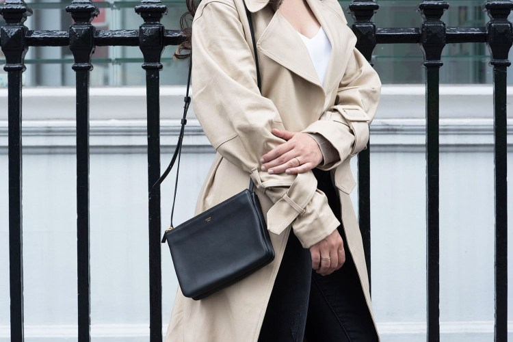 Outfit details on fashion blogger Cee Fardoe of Coco & Vera, wearing an H&M trench coat and carrying a black Celine trio bag