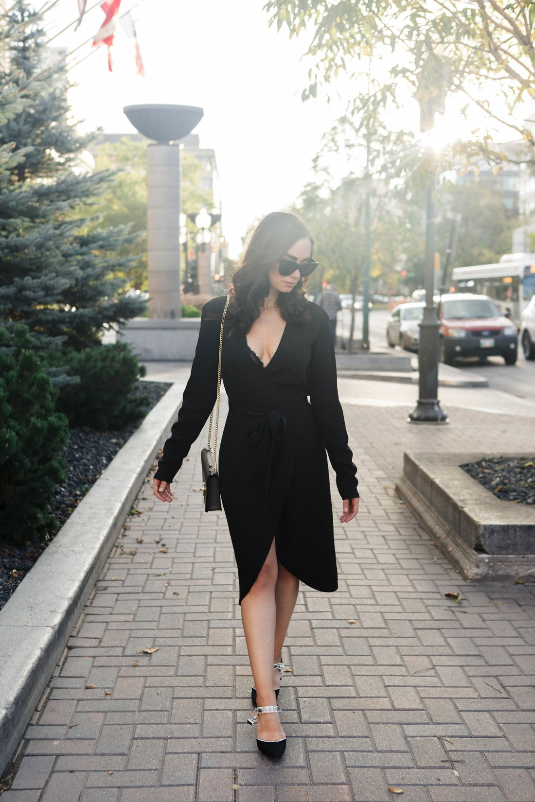 Fashion blogger Cee Fardoe of Coco & Vera walks in front of the Fort Garry Hotel in Winnipeg, wears a Rodarte x & Other Stories dress, as captured by Christa Wong Photography
