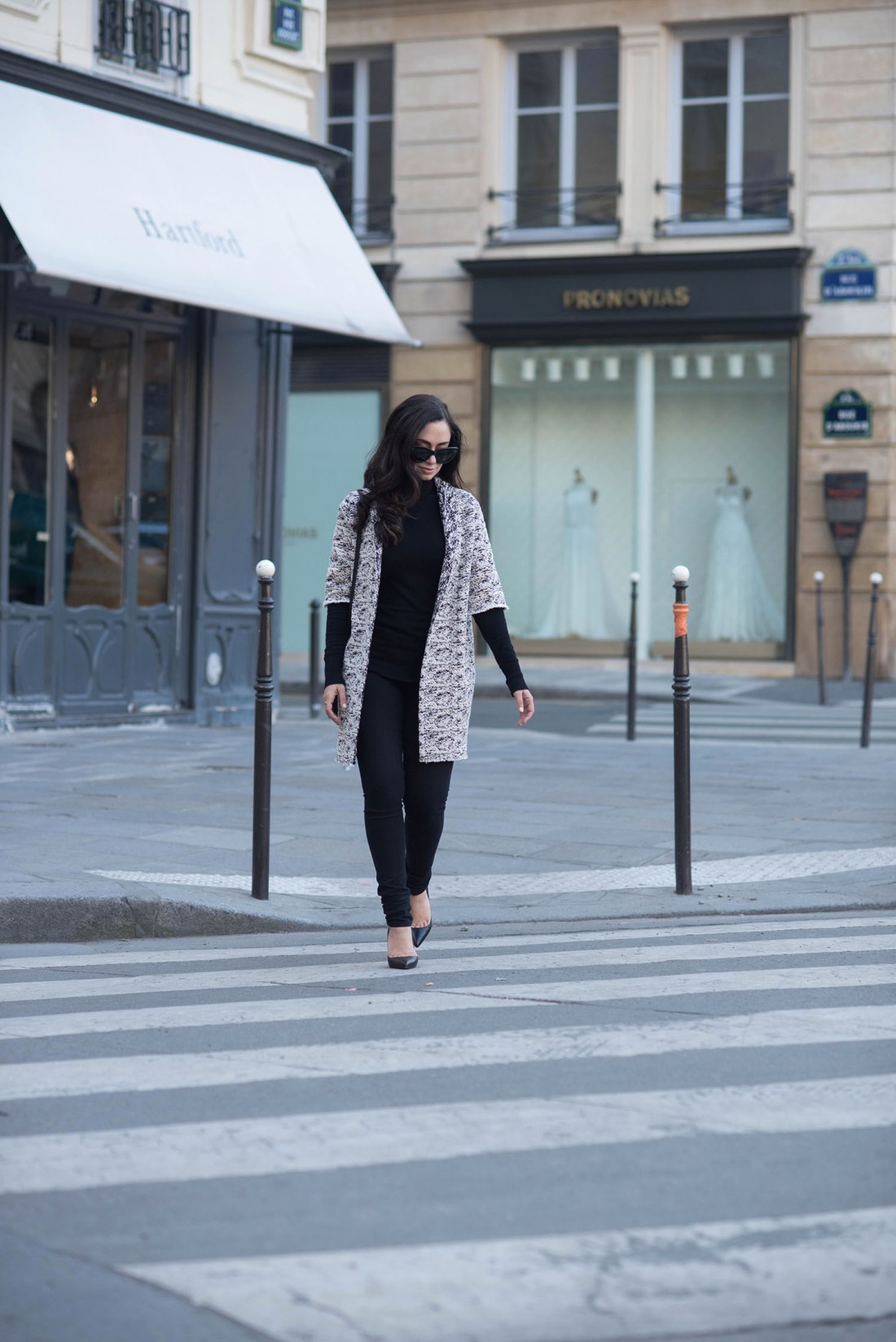 Fashion blogger Cee Fardoe of Coco & Vera wearing a Floriane Fosso coat and Christian Louboutin Pigalle pumps in Paris
