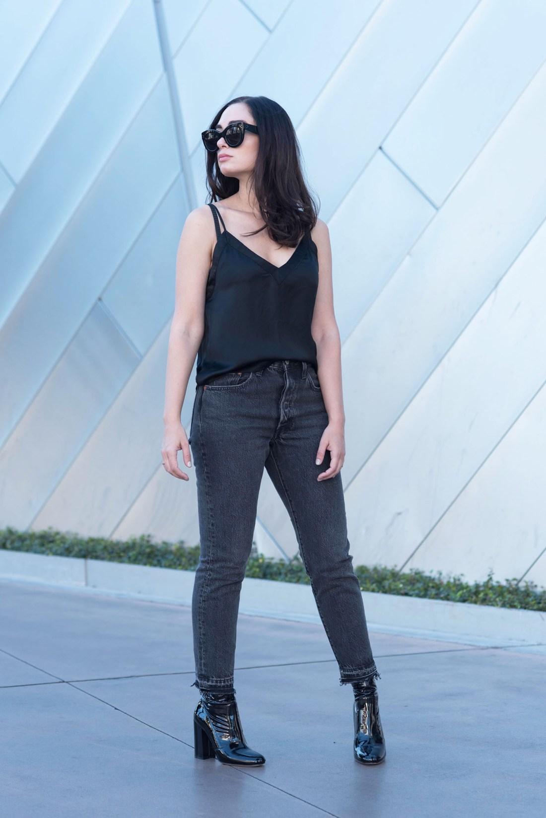 Winnipeg fashion blogger Cee Fardoe of Coco & Vera in Las Vegas wearing an Aritzia black silk tank and Levis 501 skinny jeans