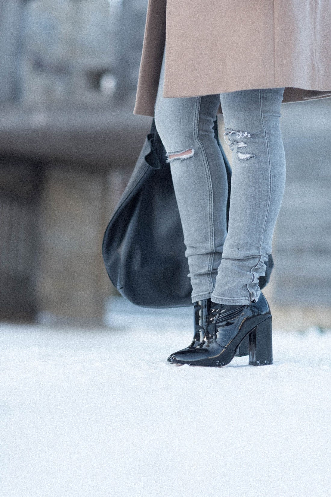 Outfit details on fashion blogger Cee Fardoe of Coco & Vera, including Ray patent leather boots and a Cuyana tote bag