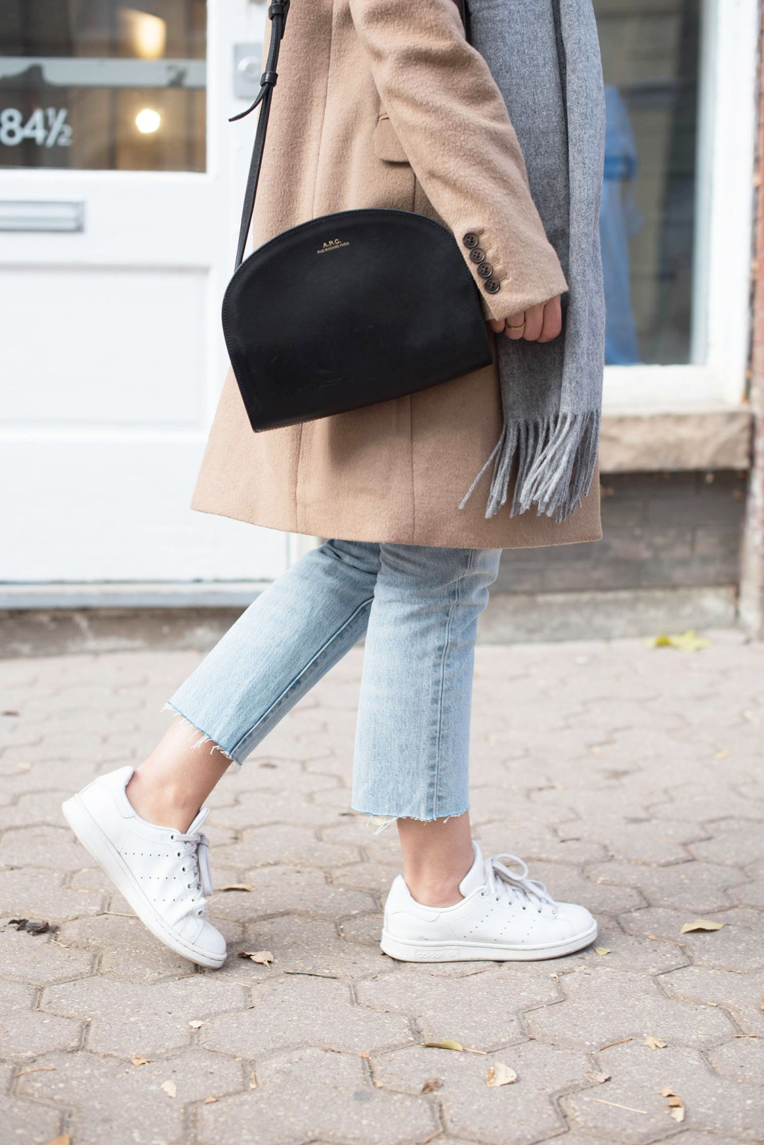 Outfit details on fashion blogger Cee Fardoe of Coco & Vera, including an APC halfmoon bag and Adidas Stan Smith sneakers