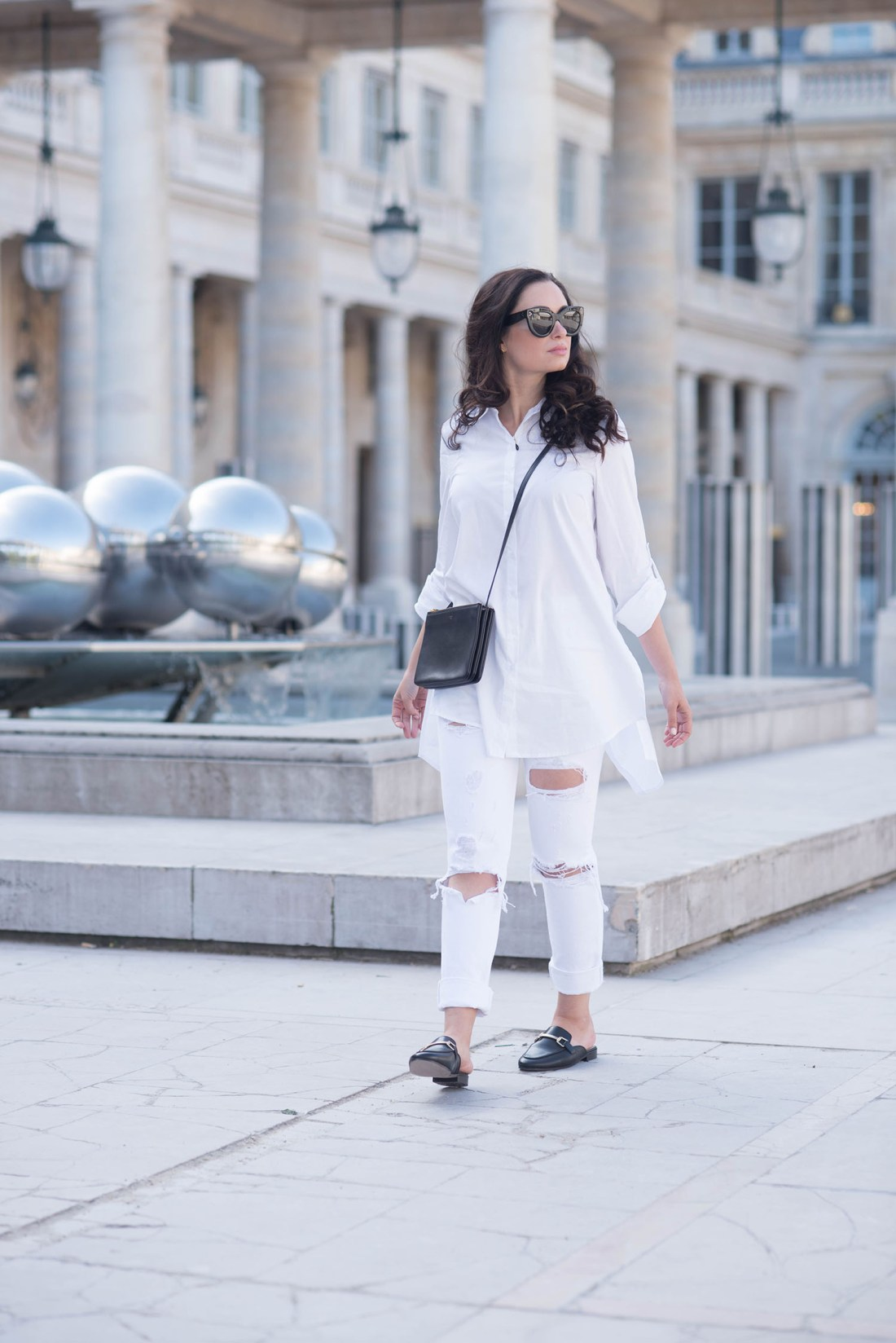 Fashion blogger Cee Fardoe of Coco & Vera at the Palais Royal in Paris, wearing Celine Audrey sunglasses and Grlfrnd Karolina white jeans