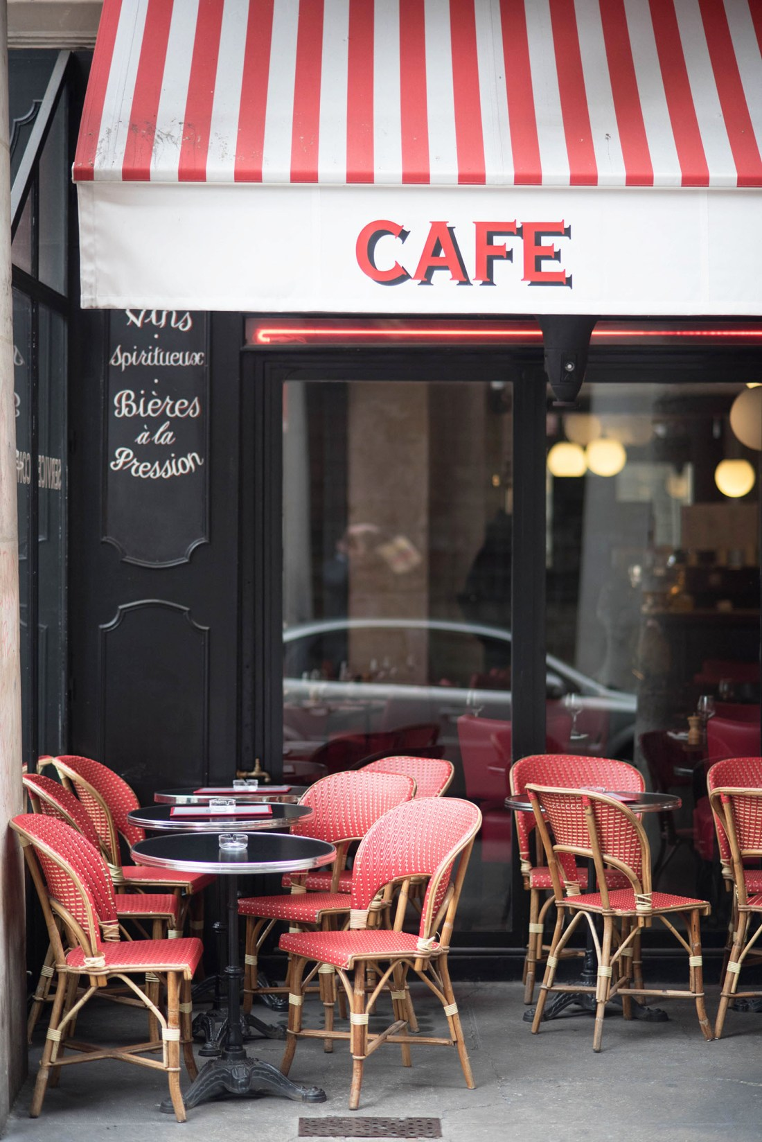 A black and red cafe in Paris, as captured by top Winnipeg travel blogger Cee Fardoe of Coco & Vera