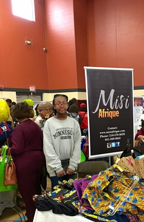 Itunu Helping out with Misi Afrique.