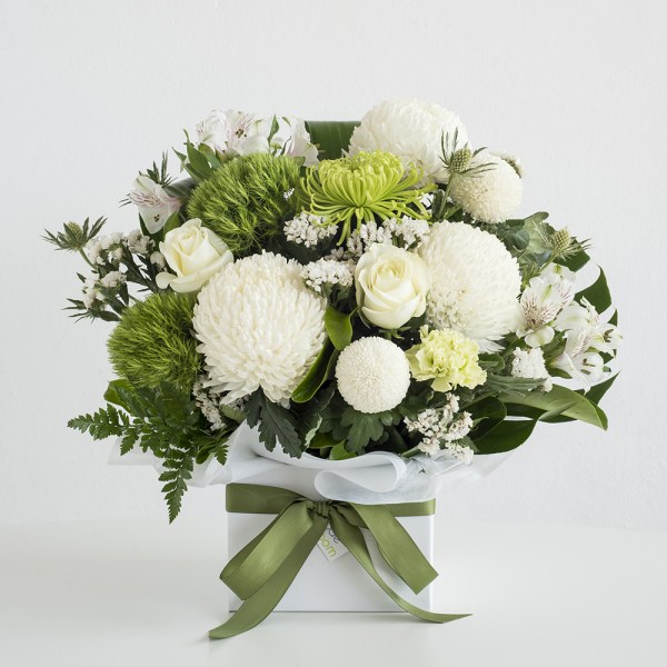 White and green flowers in a box arrangement