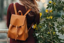 Tech student wearing brown backpack