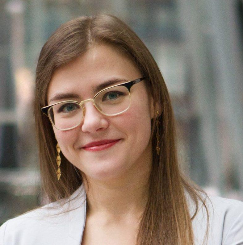 Portrait of Evelyn Csiszar in a light grey blazer.