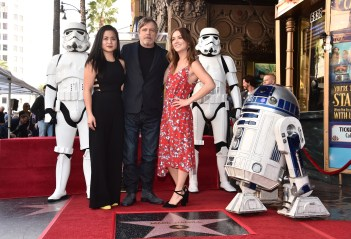 HOLLYWOOD, CA - MARCH 08: (L-R) Kelly Marie Tran, Mark Hamill, Billie Lourd at Mark Hamill Star Ceremony on the Hollywood Walk of Fame on March 8, 2018 at Hollywood Walk Of Fame in Hollywood, California. (Photo by Alberto E. Rodriguez/Getty Images for Disney) *** Local Caption *** Mark Hamill