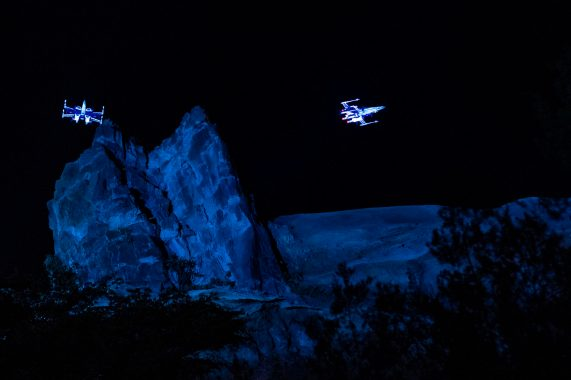 X-wing starfighters soar above Star Wars: Galaxy's Edge at Disney's Hollywood Studios as part of the dedication ceremony for Star Wars: Rise of the Resistance, Dec. 4, 2019, at Walt Disney World Resort in Lake Buena Vista, Fla. Opening to the public Dec. 5, 2019, inside Star Wars: Galaxy's Edge at Walt Disney World Resort in Lake Buena Vista, Fla., the groundbreaking new attraction invites guests into a climactic battle between the Resistance and the First Order in a thrilling Star Wars adventure of galactic proportions. (Matt Stroshane, photographer)