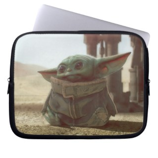 Star Wars The Mandalorian The Child Scene Laptop case You can get yours online now from Amazon, Design By Humans, Hot Topic, shopDisney, Walmart, Zazzle, and 80's Tees!