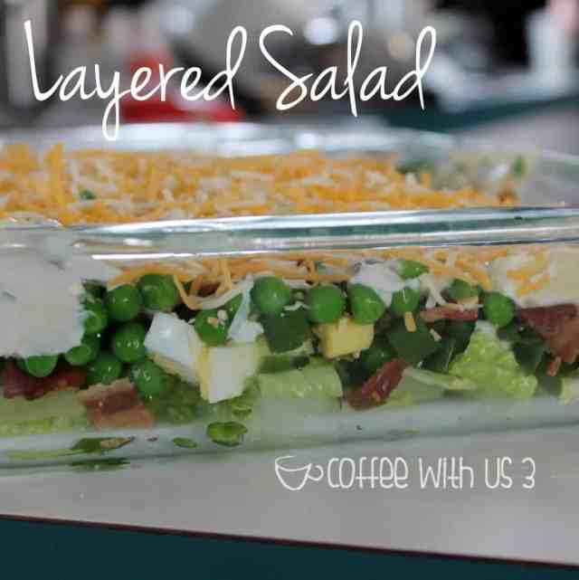 Layered Salad is the perfect recipe for a potluck or BBQ. With all those layers, there's something for everyone, and the flavors combine for perfection! Click through for the recipe!