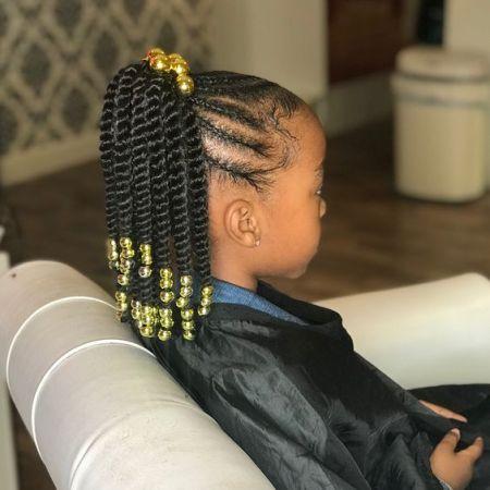 little black girl braids into a ponytail