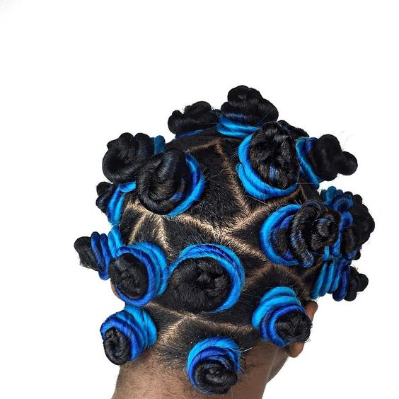 Bantu knots with blue hair extensions