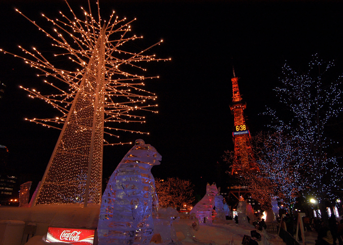 060209-N-7526R-205 Sapporo, Japan (Feb. 9, 2006) - Illuminated trees and ice sculptures line the streets leading up to Sapporo's TV Tower during the Sapporo Ice Festival. These were just some of the many spectacular ice and snow sculptures Sailors and Marines stationed aboard the amphibious command ship USS Blue Ridge (LCC 19) had a chance to see during the ship's four-day visit to Japan. Blue Ridge and the embarked 7th Fleet staff deployed in January, to complete routine port visits and community relations projects throughout the 7th Fleet area of operation (AOR). U.S. Navy photo by Journalist Seaman Marc Rockwell-Pate (RELEASED)