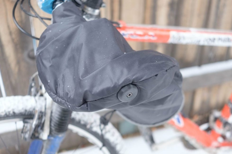 Winter Bicycle Pogie, black with bar plug attachment.