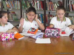 6to grado leyendo en Biblioteca 11