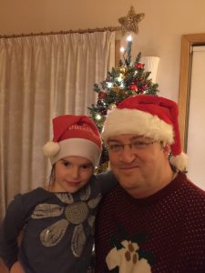 Fiona and Dad in Santa Hats