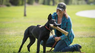 Dog Trainer Meagan Karnes with Black Malinois