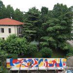 Tutti diversi, tutti uguali il muro di Lucamaleonte per Stravagante Hostel | Collater.al 1