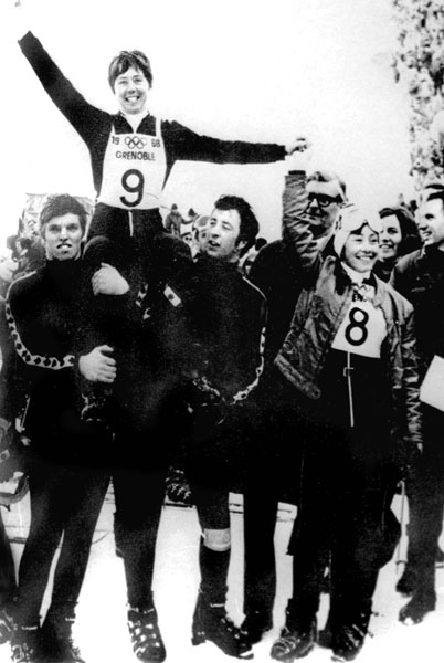 Canada's Nancy Greene (top) celebrates her gold medal win in the giant slalom alpine ski event at the 1968 Grenoble winter Olympics. (CP Photo/COA).