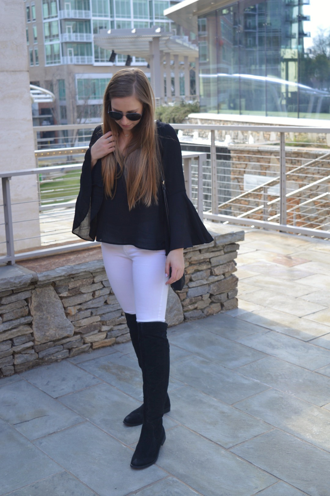 Black Bell Sleeve Top with White Denim and Over the Knee Boots