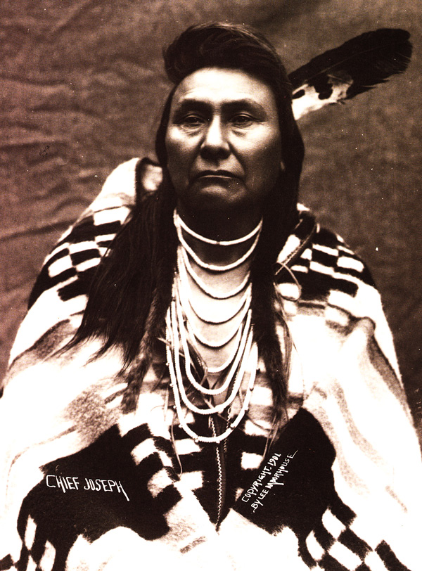 "Chief Joseph wears a Pendleton blanket in 1901. He is famous for leading a long-standing resistance to the U.S. government, which had ordered the Nez Perce to move to an Idaho reservation. Photo by Major Lee Morehouse, courtesy of Bob Kapoun, via ""Language of the Robe."""