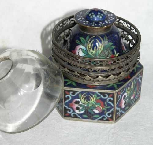 This opium lamp with extensive cloisonne ornamentation was found in New Orleans.