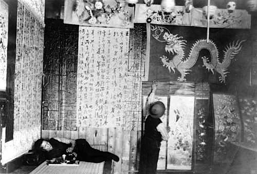 Opium smoking in Denver, Colorado, in the late 19th century. Walls of opium dens were usually covered to prevent drafts that could cause the lamp to flicker.