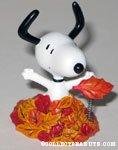 Snoopy in pile of leaves spring figurine