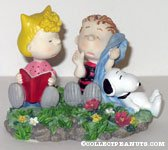 Snoopy, Sally and Linus sitting in flowers Figurine