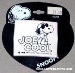 Joe Cool sitting on name Barrette